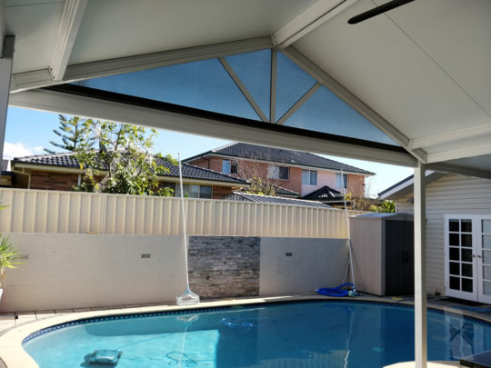 Gable insulated patio roof at Blacktown next to swimming pool